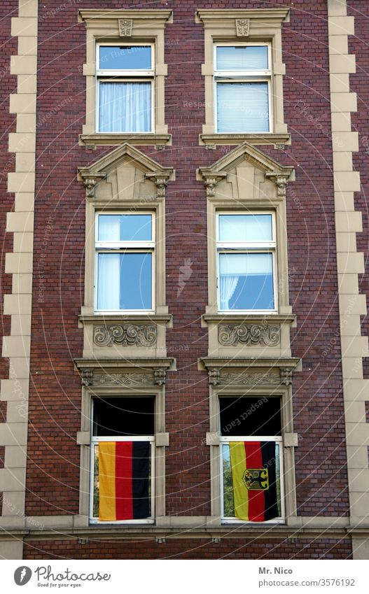 German I Neighbourhoods Germany Town House (Residential Structure) Building Window Facade High-rise flag German flag Architecture Neighbor neighbourhood