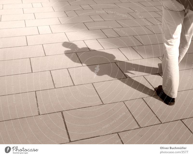 shadow man Man Sidewalk Going Legs Walking Shadow Floor covering Paving stone