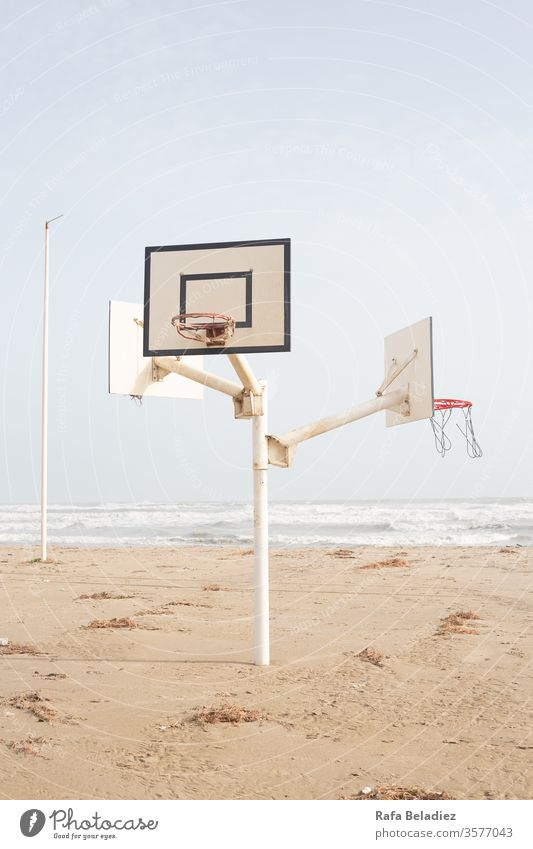 Beautiful basketball court in the middle of the beach Sport Nature Basketball Beach Sand Sun Water Ocean Minimalism