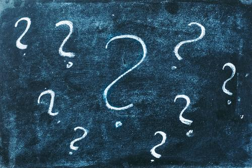 Many chalk question marks on a blackboard. Concept of ignorance, mystery and education. Question mark Ignorance Blackboard School Education Tutoring Classroom