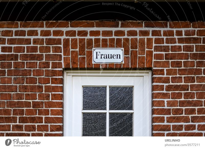 Women as lettering on an enamel sign above a glass door on a brick wall women Window Brick wall Toilet Toilet sign Deserted Colour photo Old Wall (barrier)