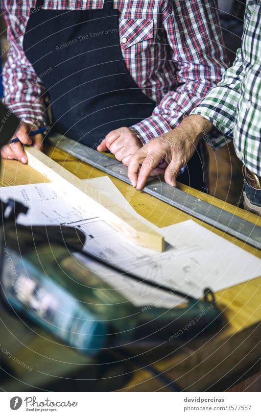 Unrecognizable older couple in a joinery Carpenter Senior citizen Couple Workshop hobby wood Artisan Detail hands labour Profession schedules Mature Business