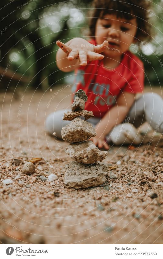 Child playing with sand Sand rocks Stone Children's game childhood Playing outdoors Nature equilibrium Balance Balanced Colour photo Infancy Exterior shot Joy