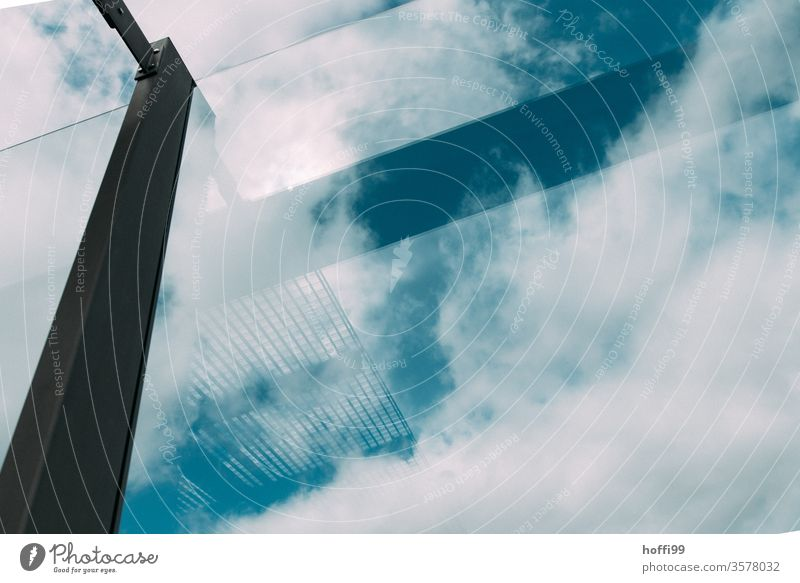 Sky with reflecting support structure of a glass façade Pane transparent Glas facade Design architectural photography Esthetic Complex reflection