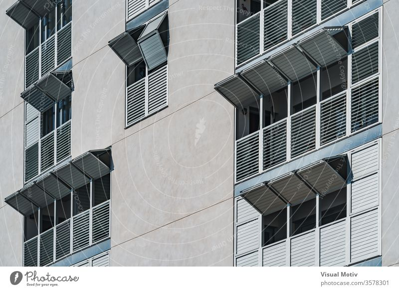 Metallic folding shutters of the facade of a modern residential building window metallic exterior folded sunny daytime urban contemporary architecture