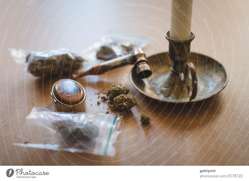 Cannabis in bags on the table Hemp Plant Intoxicant green Alternative medicine Close-up Colour photo Deserted Day Smoking thc Intoxication