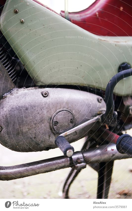 Detail picture moped - moped with gear pedal, exhaust, gearbox and cylinder with cooling fins Mofa bike Motorcycle Gear pedal Pedal detail Exhaust pale green