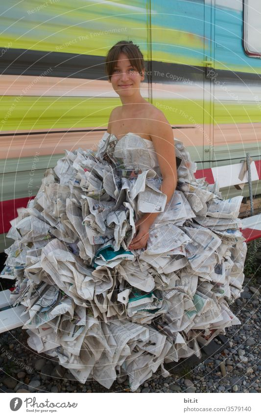 Haute couture I dress from reading material girl Young woman Newspaper Dress Media Magazine Reading matter Print media Education Information Paper Journalism