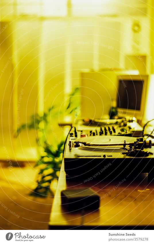 Retro DJ Turntables and old computer ambience antique audio background control decks disc dj entertain entertainment equipment indoor interior light listen lp