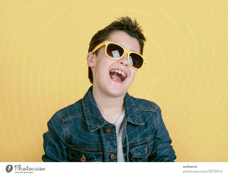 happy and smiling boy with sunglasses kid childhood protection cool summer lifestyle fashion modern happiness positive portrait smile people expression fun