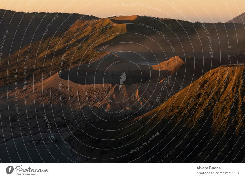 Sunrise close-up at the active volcano Bromo, and the Tengger massif, in East Java, Indonesia. landscape travel photography sunrise hillside sky last lights