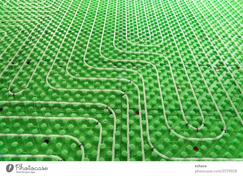 Part of floor heating installation system underfloor radiant construction water plastic tube house hot hydraulic work installing indoor pipe thermal ground