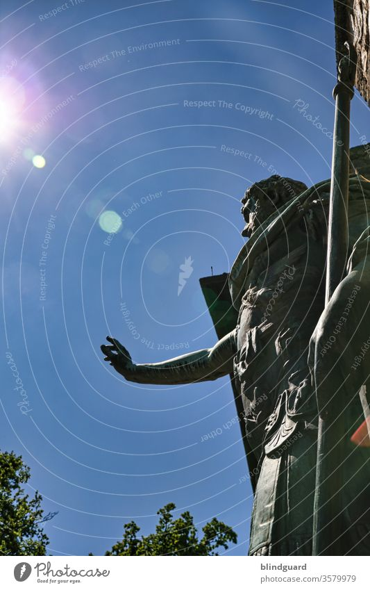 Ave... Romans greet the sun! Roman statue in front of the Roman fort Saalburg am Limes in Hesse raises its hand to greet visitors and holds a spear in its hand