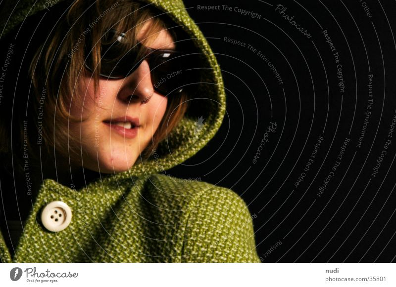 Woman Green Black Dark Hair and hairstyles Head Large Coat Sunglasses Buttons Hooded (clothing) Eyeglasses