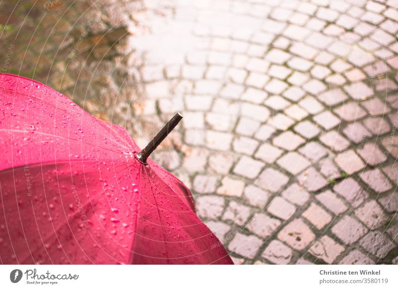 Umbrella in pink and natural stone - pavement, wet and shiny Magenta Umbrellas & Shades Rain Wet Puddle Paving stone natural stone pavement porphyry chill