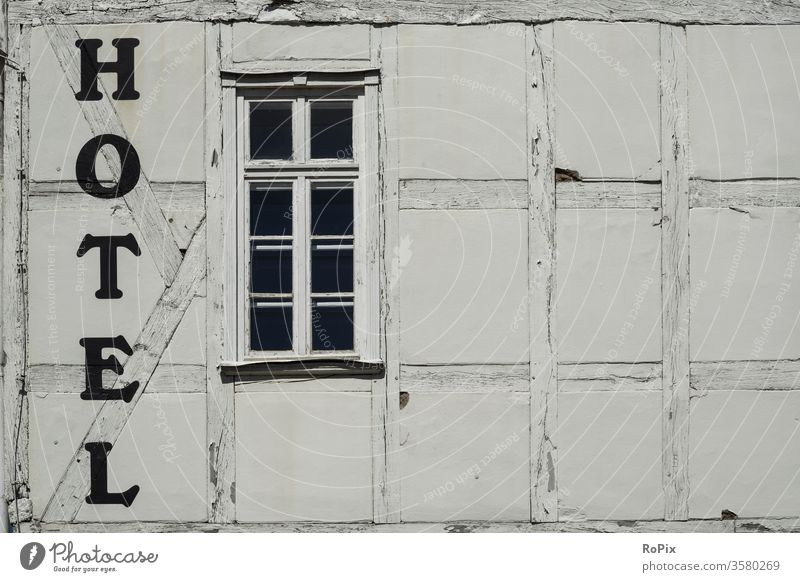 Historic half-timbered hotel facade... monochrome background granite rampart isolates concrete green paint industry close industrial structure abstract stripes