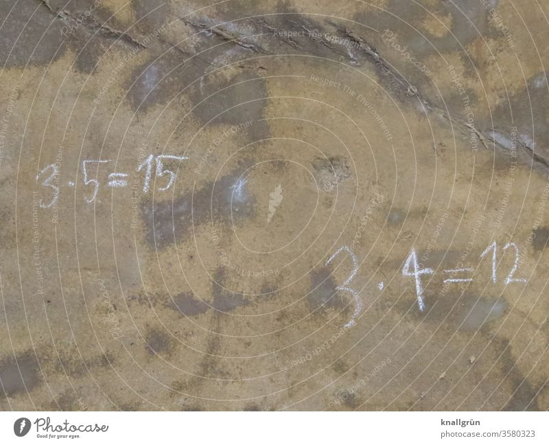 3 x 5 = 15 and 3 x 4 = 12 written with chalk on a brown stained wall Mathematics Digits and numbers Calculation figures Study Close-up Colour photo Deserted