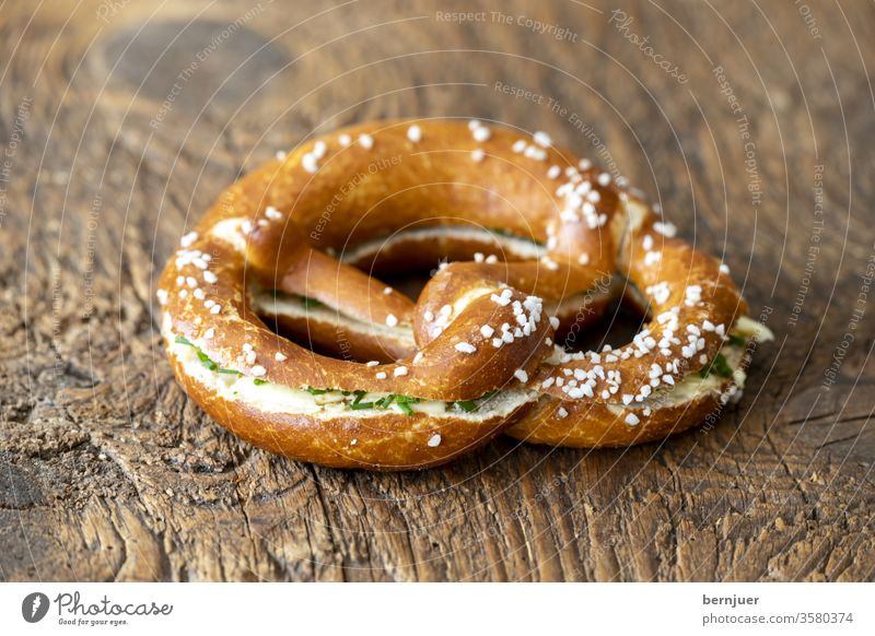 Bavarian pretzel with butter on wood Pretzel butter pretzel Butter pretzel Bread Germany Snack Fresh Breakfast Delicious Coffee background Eating Table
