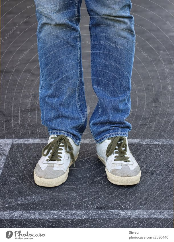Jeans and sneakers Legs Male Legs feet foot Footwear jeans dress code casually smart casual Stand Street Asphalt Human being Exterior shot Multicoloured