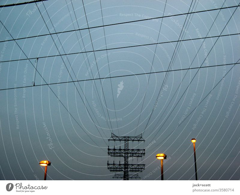 some high voltage lines up to the small street lamps power line Environment Electricity pylon Transmission lines Technology Energy industry Sky