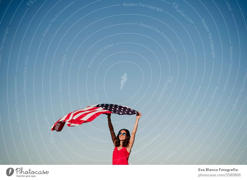young woman holding United States flag outdoors at sunset. Independence day in America, 4th July concept united states independence day july america freedom