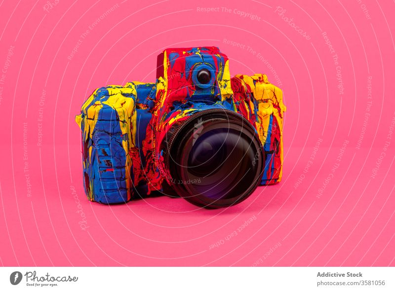 Colorful photo camera on bright background color colorful photography creative retro art design paint inspiration concept style hobby memory vivid vibrant