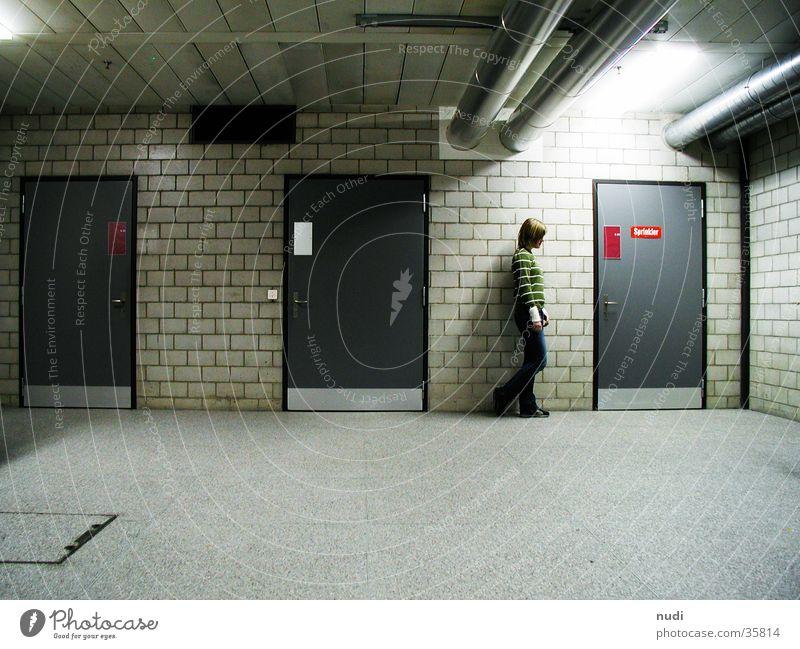Woman Loneliness Dark Wall (barrier) Think Moody Room Door Factory Floor covering Storage