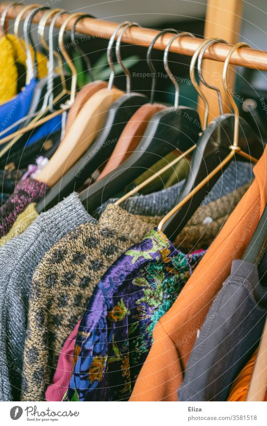 Clothes on a clothes rail in a Second-Hand shop or at the flea market garments Second-hand shop second hand shank vintage Fashion Clothing Flea market favorable