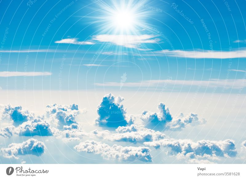 Blue sky with white clouds sun nature blue background cloudscape aerial sun rays light color beautiful day high cumulus weather sunlight summer beauty air