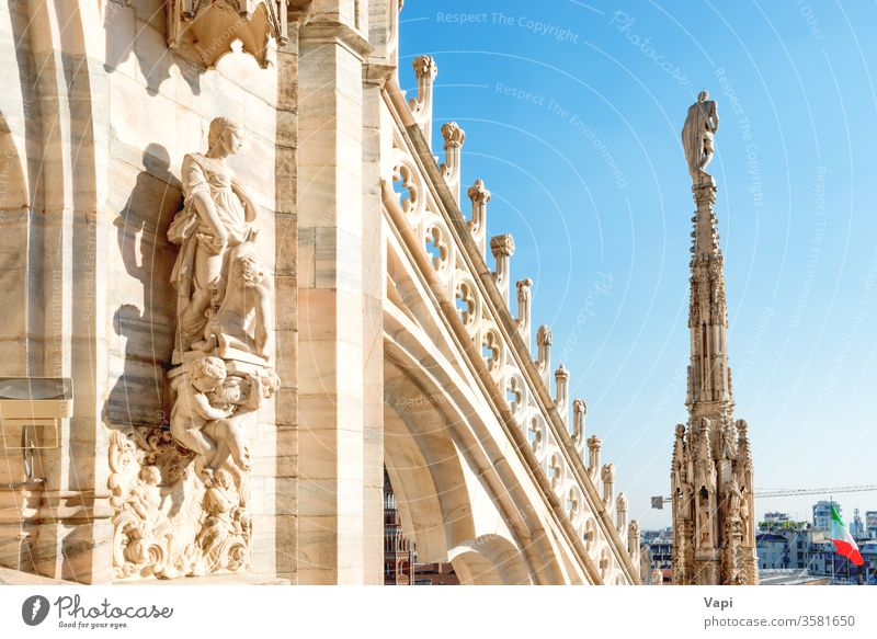 Statues and decoration on roof of Duomo in Milan milan cathedral gothic duomo architecture terrace statues marble beautiful blue sky landmark top italy milano