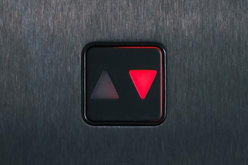 Red down arrow symbol Arrow Downward Elevator Direction Signs and labeling Note symbol Colour photo Trend-setting Orientation Deserted Signage Close-up