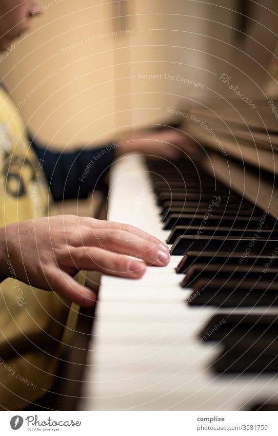 piano lesson Piano E-piano fumble Keyboard Music play music Make music Boy (child) Child Study Fingers Classical Song Passion Teacher