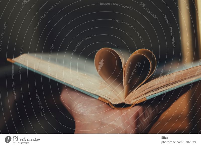 A heart from the pages of a book. Concept Love of literature and reading. Book Reading Literature Passion Heart concept Novel Education Read out loud