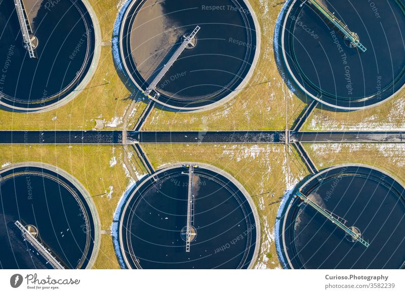 Sewage farm. Static aerial photo looking down onto the clarifying tanks. Industrial place. Geometric background texture. Photo captured with drone. treatment