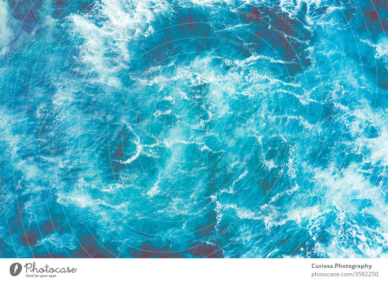 Aerial view to the sea waves. Blue water background. Photo taken from above by a drone. Ocean Antenna Beach Water Top Wave Waves Nature drones Summer Coast