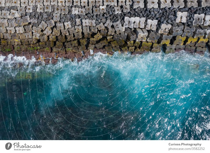 Aerial view to ocean waves. Blue water background. Photo made from above by drone. sea top beach aerial nature blue texture abstract travel summer coast