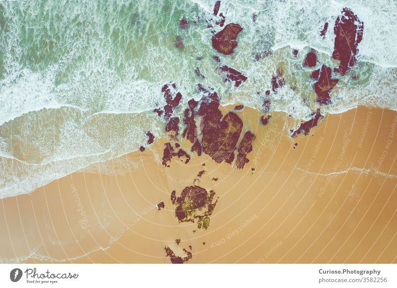 Aerial view to ocean waves. Yellow sand beach. Blue water background. Photo made from above by drone. sea top aerial nature blue texture abstract travel summer