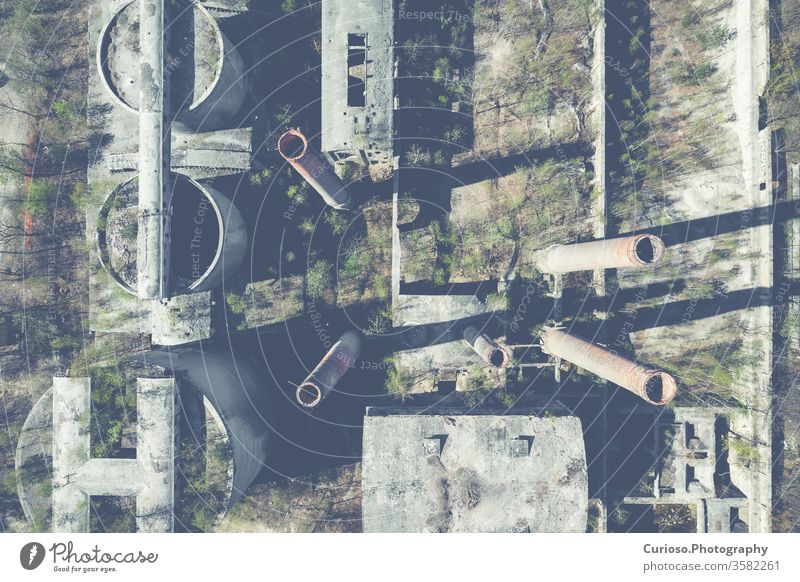 Aerial top view of abandoned industrial place. Photo made by drone from above. factory building old warehouse background interior industry dark grunge urban