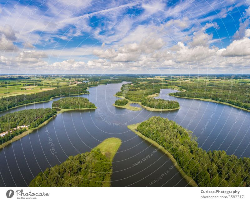 Aerial view of green islands and clouds at summer sunny day.Wydminy lake on Masuria in Poland. poland aerial mazury masuria beautiful landscape nature natural