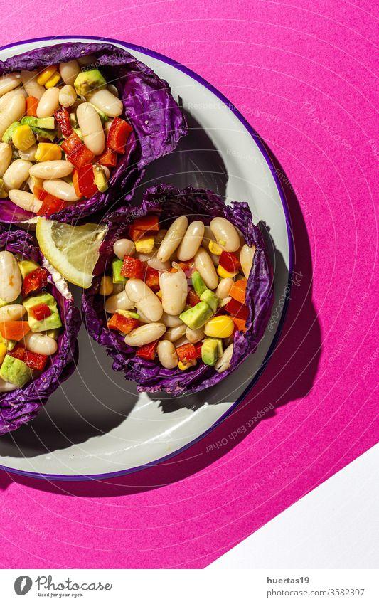 homemade bean salad with carrots, avocado, pepper food beans Purple cabbage corn olive oil lemon juice vegan food diet healthy lunch bowl dinner meal appetizer