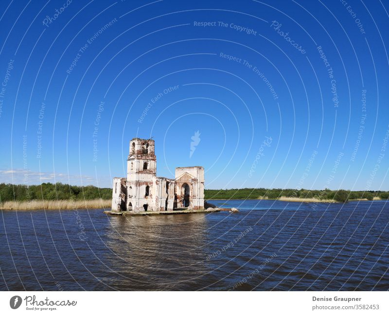 church on the rybinsker reservoir russia river architecture water landmark landscape religion travel old sky tower city tourism belfry cathedral history nature