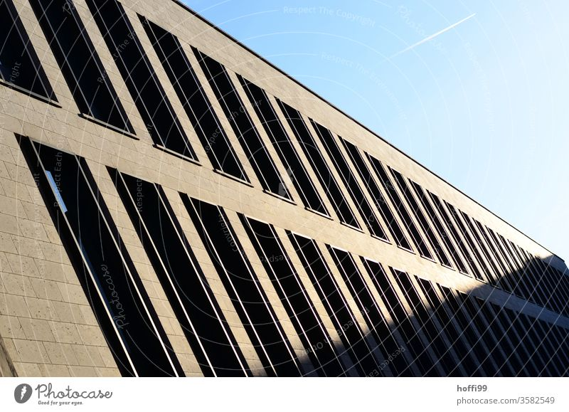 Shadow play with contrails in the sky Vapor trail Aviation Airplane Climate change Facade Window Venetian blinds Architecture Bank building