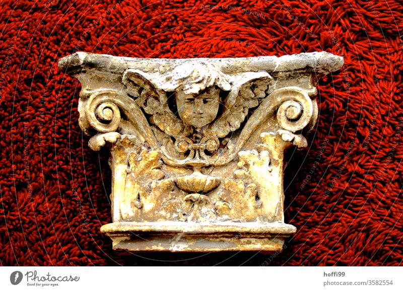 neoclassical facade element with pinched putto - neatly presented on red plush Neoclassicism Sculpture Putto Historic Component Ornament Cladding