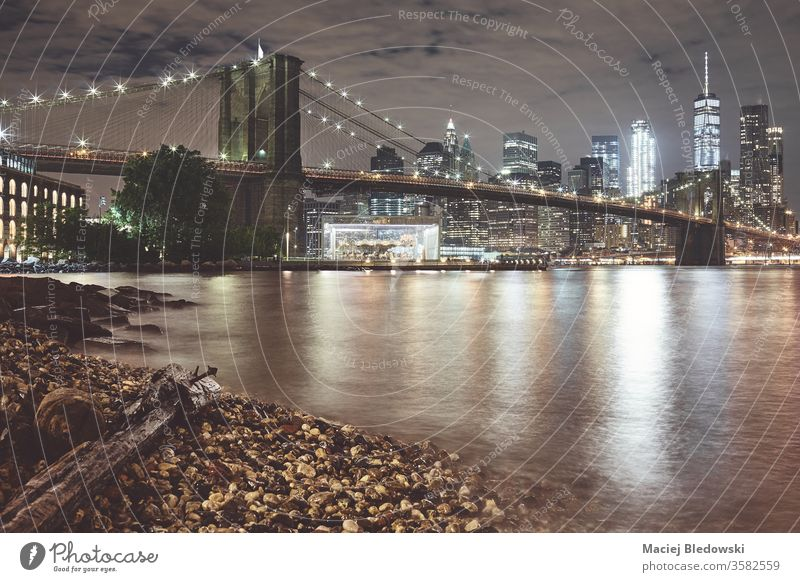 Brooklyn Bridge and Manhattan at night, New York. new york brooklyn bridge city manhattan skyline water reflection usa urban famous nyc panorama filtered toned