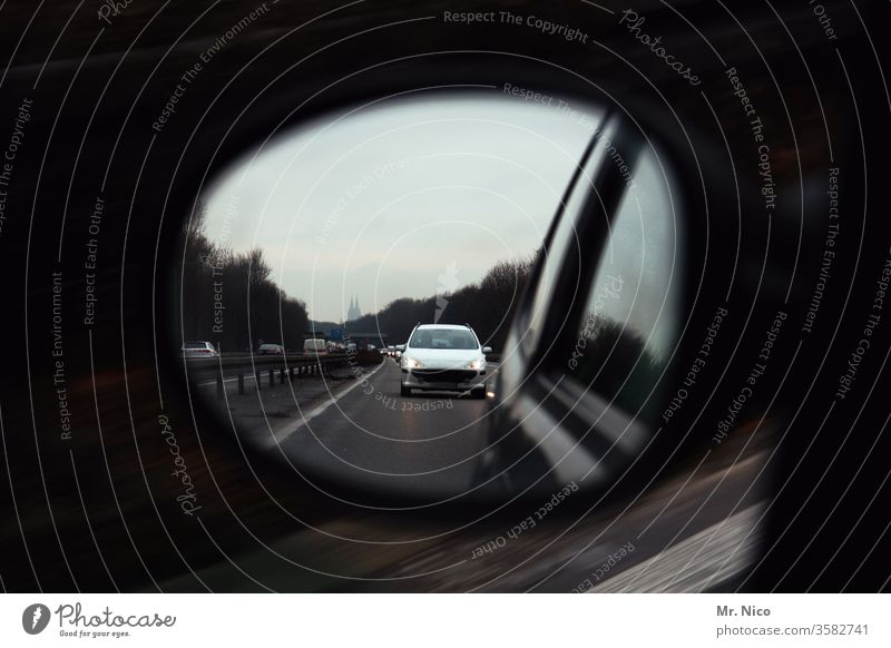 Car in the exterior mirror Rear view mirror Motoring Highway Chase Transport Street Traffic infrastructure Driving Road traffic Speed Vehicle Vacation & Travel