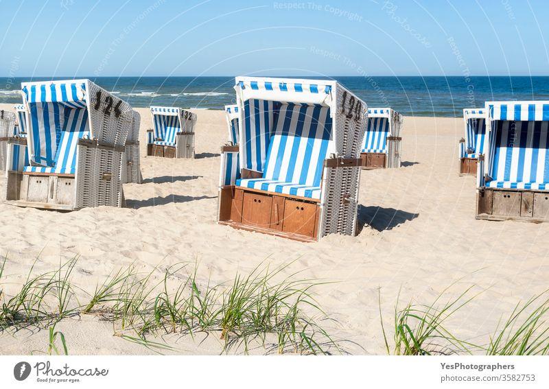 Beach chairs on the sand at the North Sea on Sylt island. Summer vacation Frisian island Schleswig-Holstein Wadden sea beach beach chairs coastline dunes