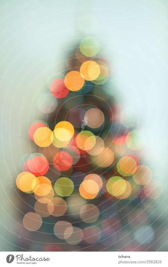 Defocused Christmas tree with lights celebrating holidays fir snowflake snowflakes religion close-up home x-mas magic symbol branch space balls interior happy