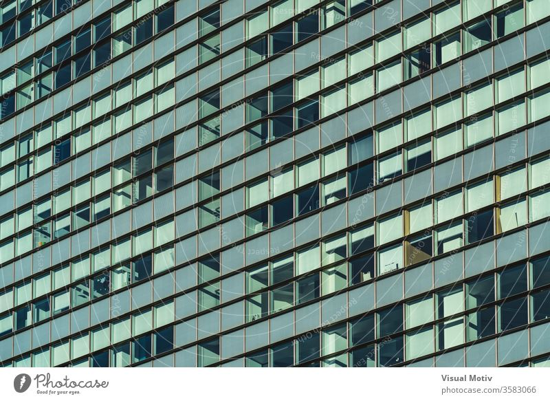 Rows of glazed windows of the facade of a modern office building rows glass urban architecture metropolitan financial contemporary outdoor district area