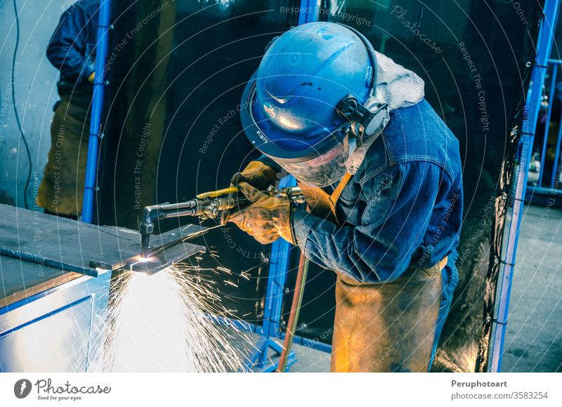 Man cutting iron builder building business circle construction disk electric electricity equipment factory grind hand industry machine man manufacturing metal