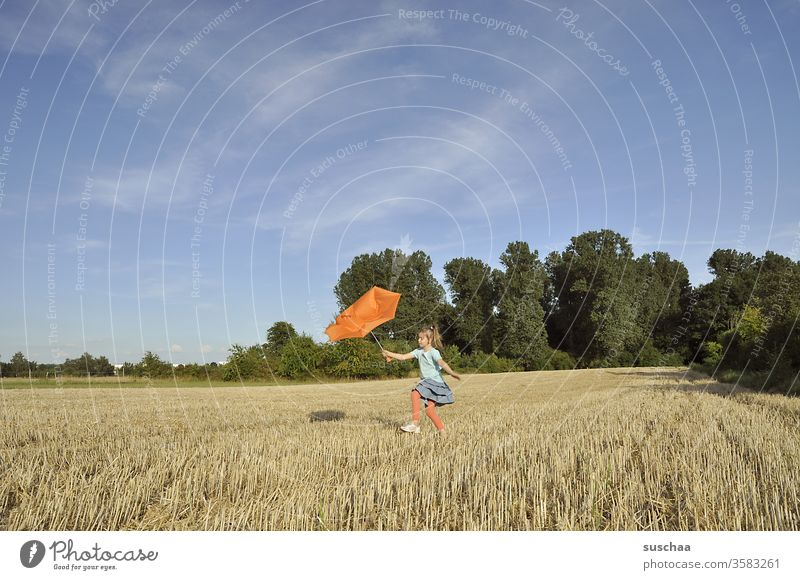child with a broken orange umbrella on a summery stubble field Child girl Summer out Summery Beautiful weather Nature Landscape Stubble field straw field acre